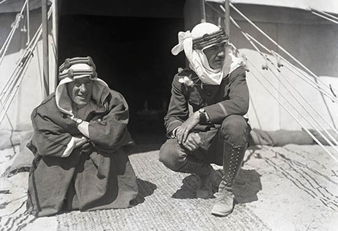 "TE Lawrence and Lowell Thomas in 1918 photo in front of their tent. From Marist College Exhibit reenacting Lowell Thomas' performance, ""With Allenby in Palestine and Lawrence of Arabia"""
