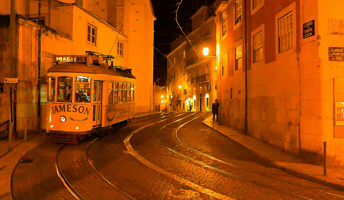 Nighttime scene of a tram in Lisbon